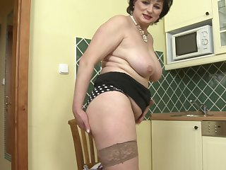 Mature Dalia plays with her pussy and her favorite dildo in her larder