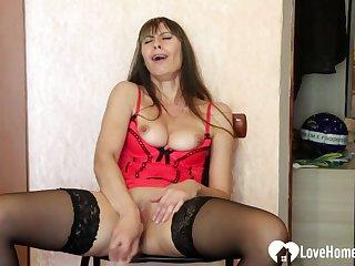 Naughty stepmom in stockings uses a dildo