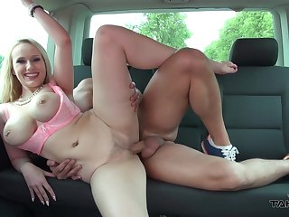 Busty blonde MILF Angel boned to one's liking in the back seat of a car
